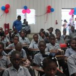 Haitian children attend ribbon cutting ceremony for new communit